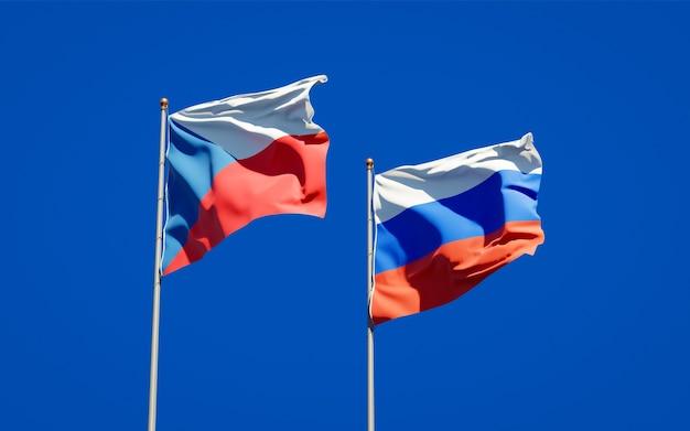 Beaux drapeaux nationaux de la russie et de la république tchèque ensemble sur le ciel bleu. illustration 3d