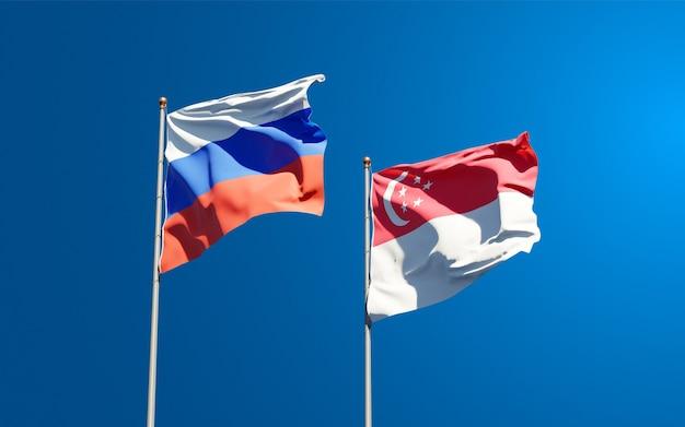 Beaux drapeaux nationaux de la russie et de singapour ensemble