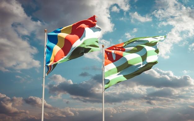 Beaux drapeaux nationaux des seychelles et de l'abkhazie ensemble
