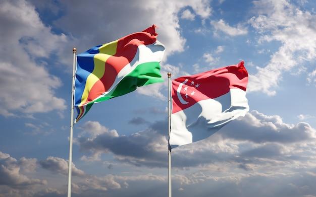 Beaux drapeaux nationaux des seychelles et de singapour ensemble