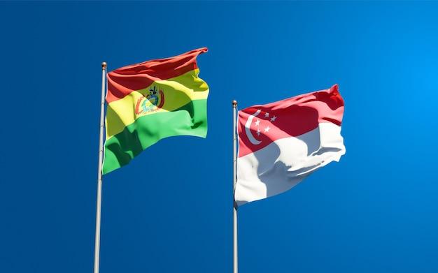 Beaux drapeaux nationaux de singapour et de la bolivie