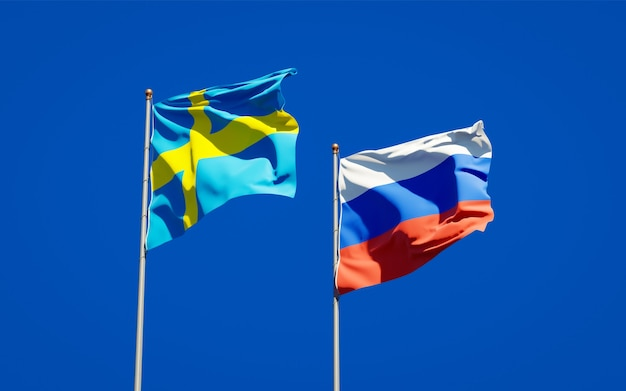 Beaux drapeaux nationaux de la suède et de la russie ensemble sur le ciel bleu. illustration 3d