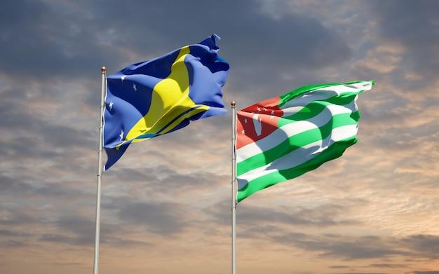 Beaux drapeaux nationaux des tokélaou et de l'abkhazie ensemble