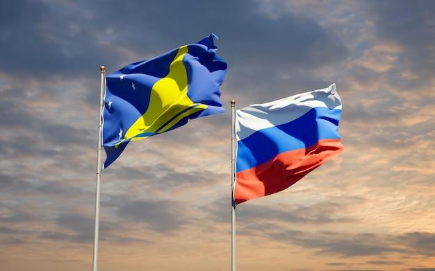 Beaux drapeaux nationaux des tokelau et de la russie ensemble sur le ciel bleu. illustration 3d