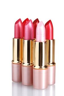 Beaux rouges à lèvres isolés sur blanc