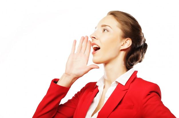 Belle femme d'affaires faisant signe de silence sur blanc