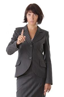 Belle femme d'affaires pointant isolé sur blanc