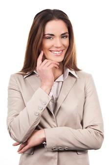 Belle femme d'affaires posant isolé sur blanc