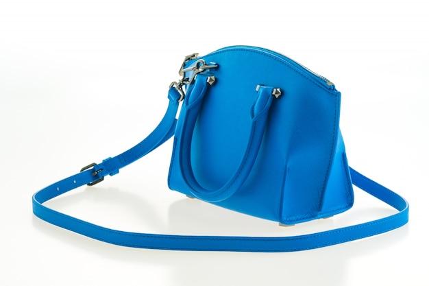 Belle femme élégante et de mode de luxe et sac à main bleu