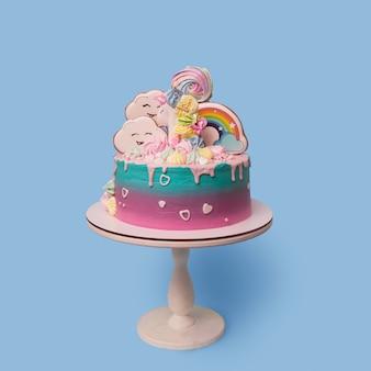 Belle fête avec gâteau pour enfants licorne sur un support sur un bleu