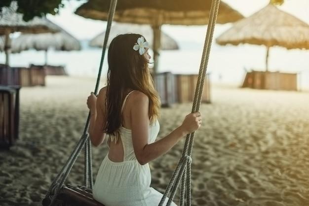 Belle fille assise sur une balançoire et regarde le lever du soleil
