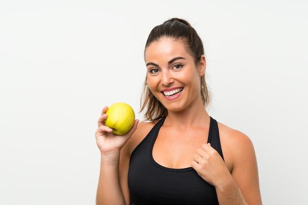 Belle jeune fille avec une pomme