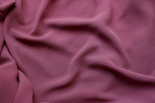 Belle texture de fond de tissu poussiéreux rose, beau gros plan de tissu