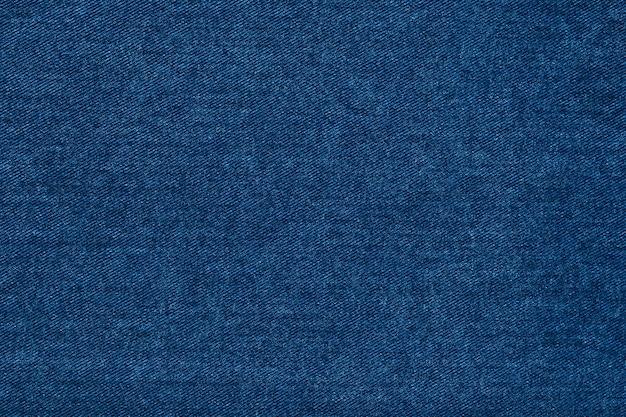 Belle texture de tissu bleu denim indigo.
