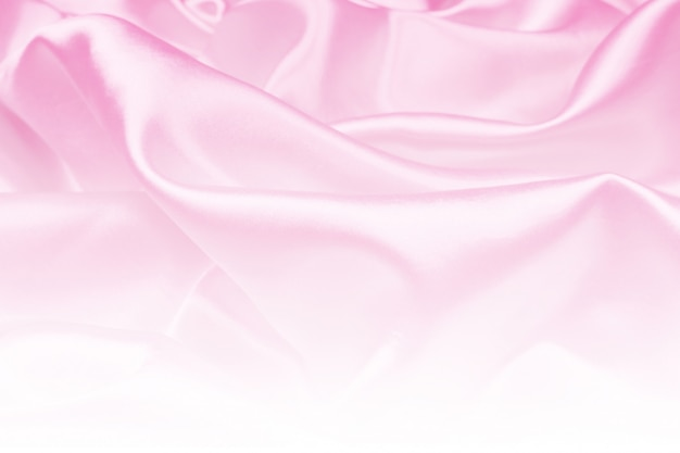 La belle texture de tissu de luxe en satin rose peut servir de fond de mariage, de tissu