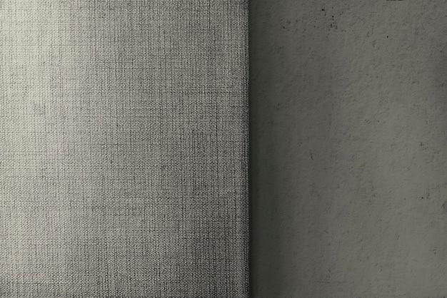 Béton beige et toile de fond texturé en tissu