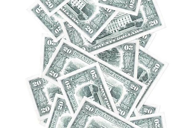 Billets de 20 dollars américains volant vers le bas isolé sur blanc