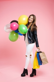 Birtday girl in amazing outfit looking straight holding cadeaux