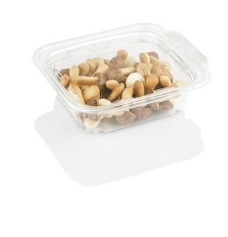 Biscuits aux pépites de chocolat en forme de champignons dans une boîte transparente isolée
