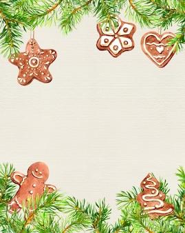 Biscuits de noël, homme au gingembre, cadre de branches de conifères. carte de noël. aquarelle