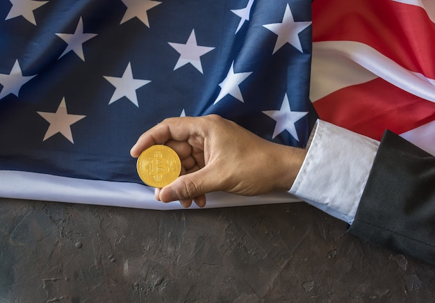 Bitcoin d'or entre les mains d'un dirigeant