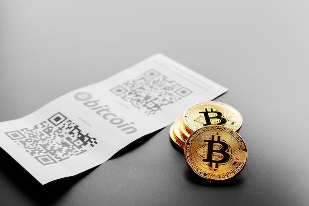 Bitcoin pièces d'or et facture papier