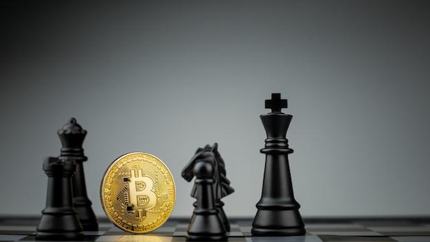 Bitcoins dorés sur un échiquier