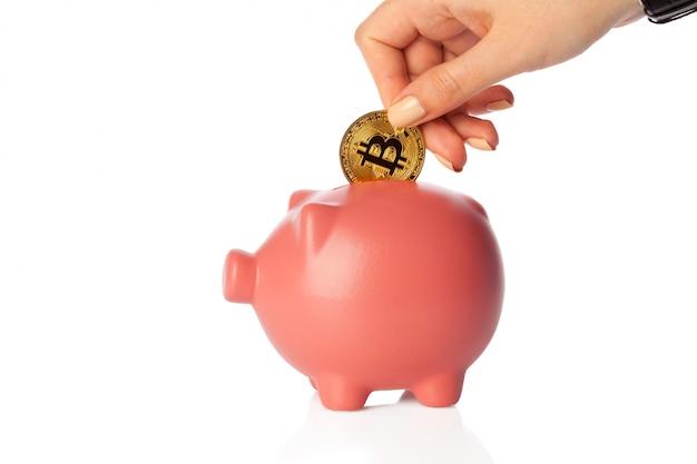 Bitcoins épargnant dans une tirelire