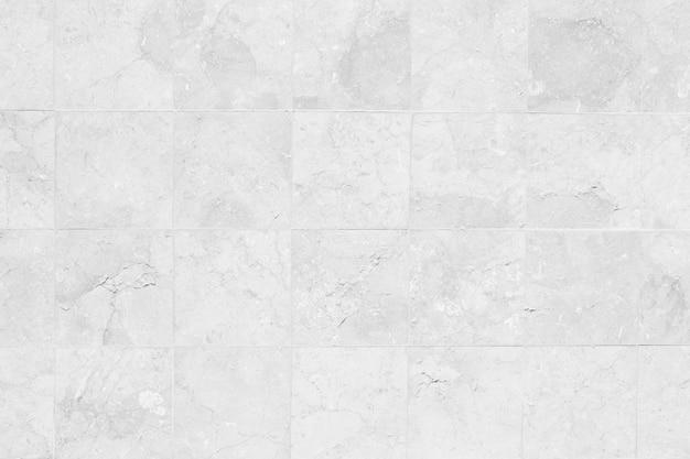 Blanchâtre mur de briques grises