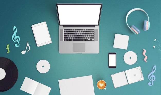 Bleu bureau avec un ordinateur portable et des disques compacts