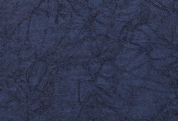 Bleu foncé ondulé un matériau textile. tissu avec texture naturelle.