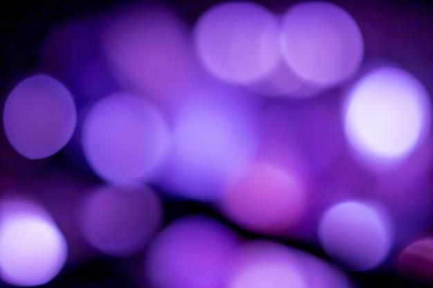 Bleu marine paillettes argent noël texture abstraite lumière scintillante étoiles sur bokeh. lumières vintage scintillantes