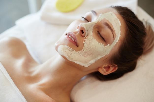 Blissful woman enjoying spa