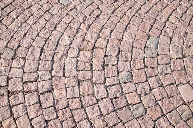 Bloc de brique carré en pierre à pied pour fond de texture.