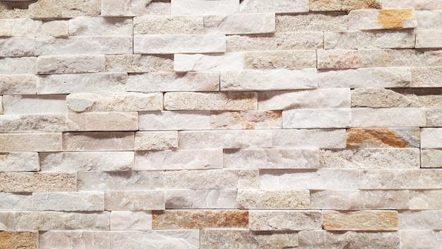 Bloc clair de mur de brique comme texture de fond