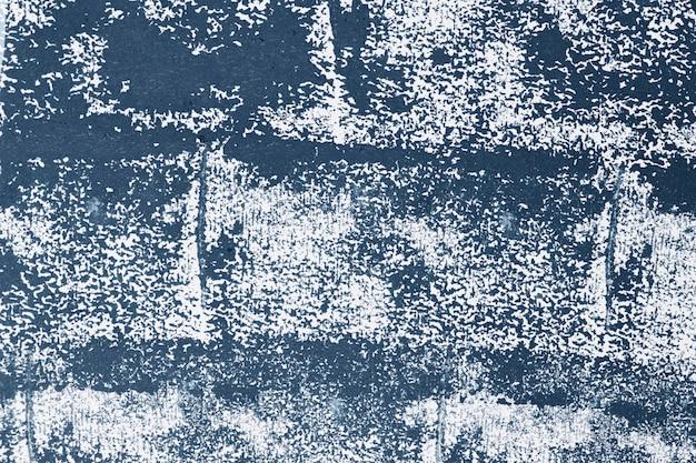 Le bloc de fond rugueux texturé bleu imprime sur le tissu