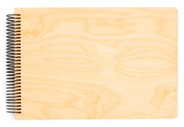 Bloc-notes en spirale de métier en bois de papier d'isolement sur le blanc