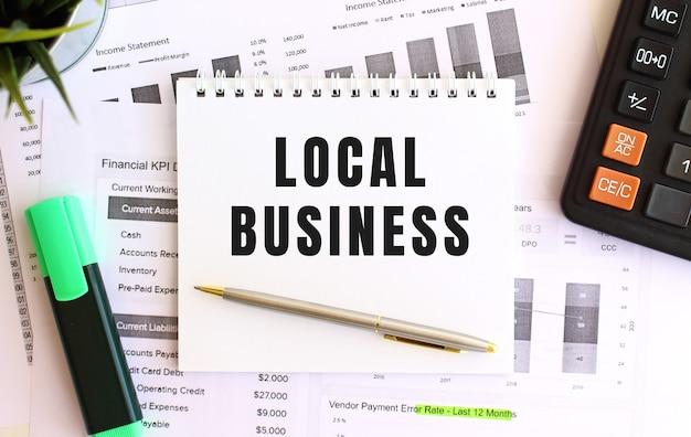 Bloc-notes avec texte concept d'entreprise locale