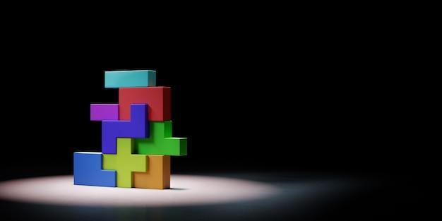 Blocs colorés combinés sous les projecteurs isolés