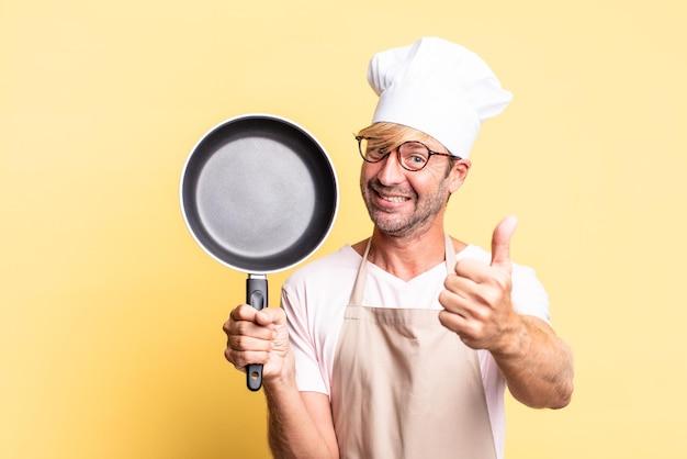 Blonde beau chef homme adulte tenant une casserole