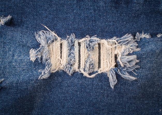 Blue jeans déchiré fond de texture, concept de mode