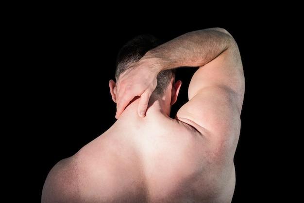 Bodybuilder fort avec cou douloureux