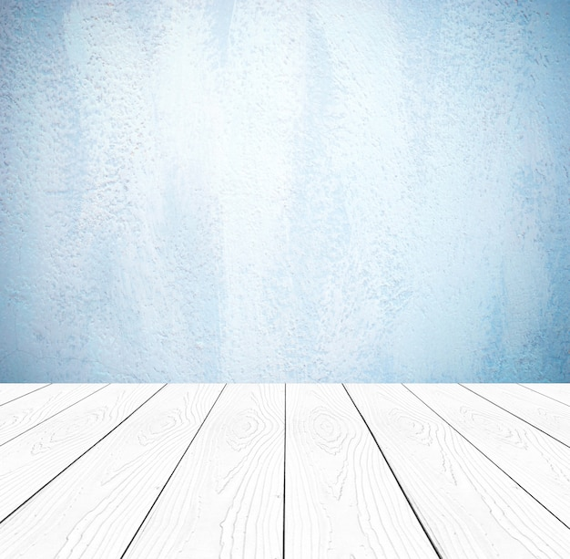 Bois de perspective vide blanc et fond de mur de ciment bleu