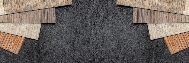 Le bois de sol en vinyle échantillonne de petites images de planches colorées pour la conception avec un espace de copie sur un sol en vinyle noir ...