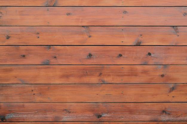Bois verni de l'extérieur de la cabine. planche de bois brun