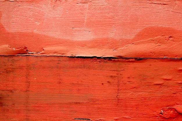 Bois vieilli patiné peint en rouge orange