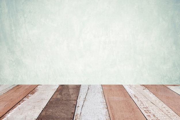 Bois vintage de perspective sur fond de mur de ciment vert