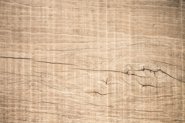 Boiserie marron vue de dessus avec fissure, vieux fond en bois texturé foncé grunge