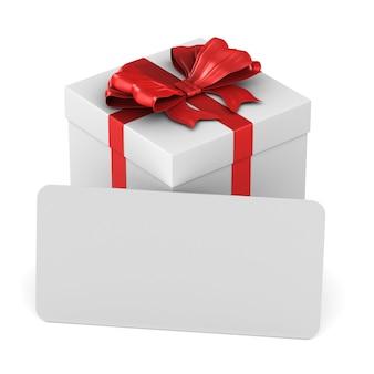 Boîte blanche avec noeud rouge et étiquette sur blanc