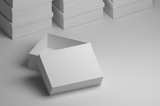 Boîte blanche ouverte avec un espace vide pour le texte ou la présentation. boîtes d'emballage blanc sur fond blanc.